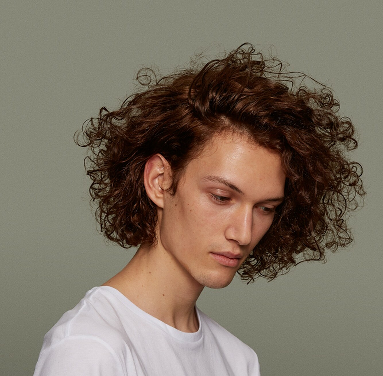man with curly, brown hair