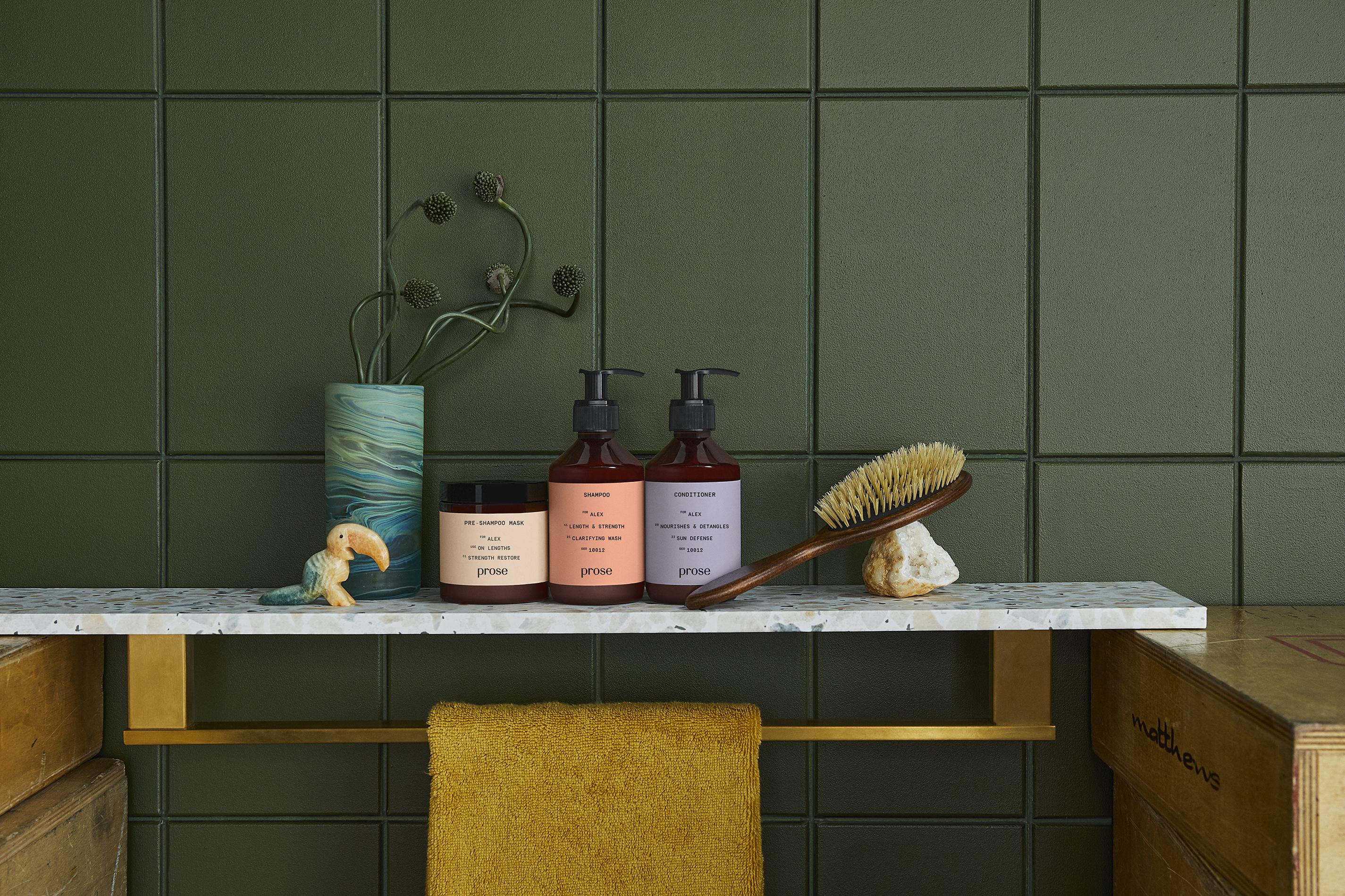 prose custom pre-shampoo hair mask, shampoo, and conditioner in a green tiled bathroom