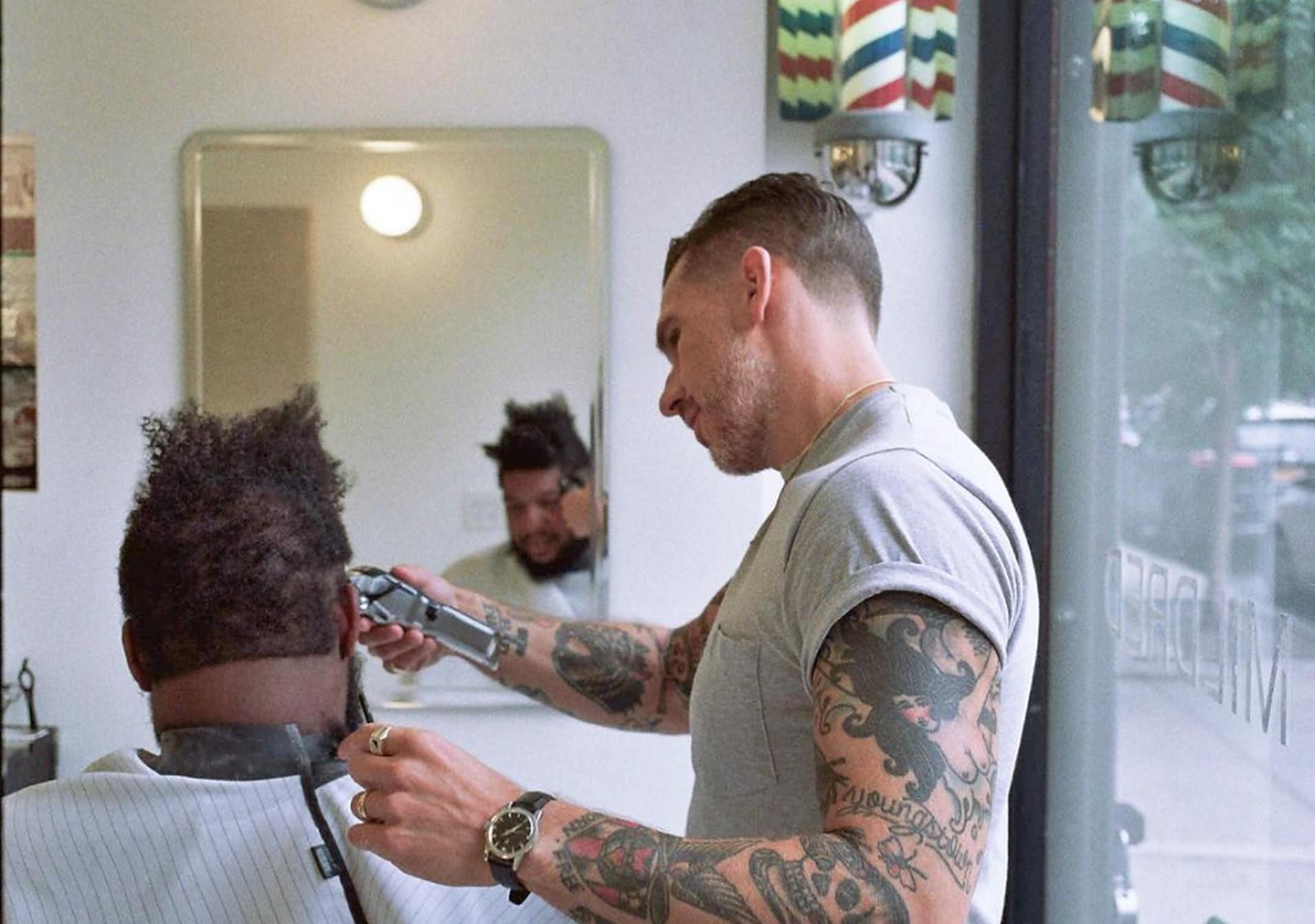 barber cutting a man's hair