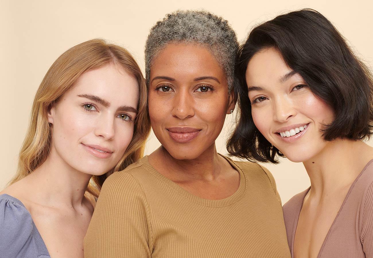 three older women smile