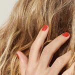 woman touching her blonde hair