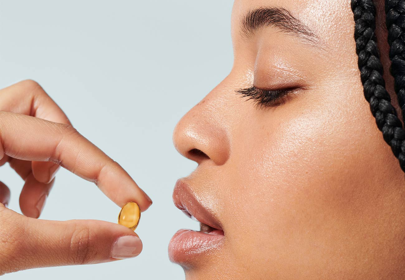 woman taking hair vitamins