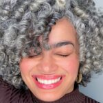 woman with curly silver hair