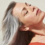 woman with long silver and grey hair