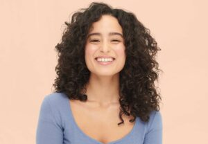 woman with dark, curly hair