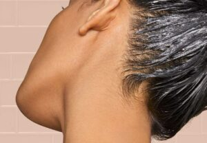 woman with a scalp mask in her hair