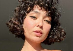 woman with brown, curly bob haircut