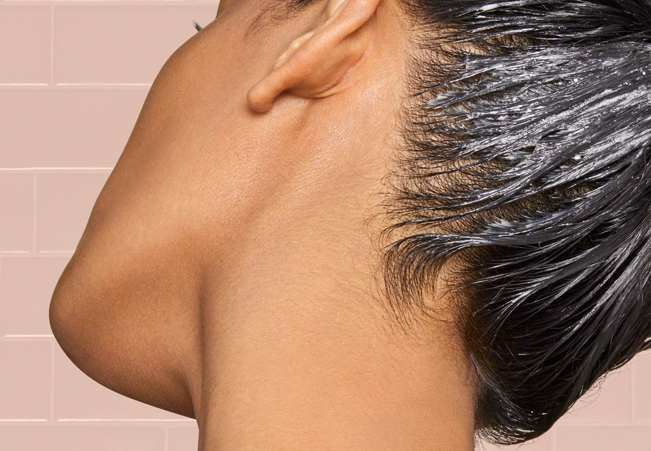 woman with hair mask in her hair