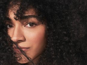 woman with brown, curly hair