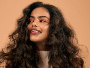 woman with voluminous, brown hair