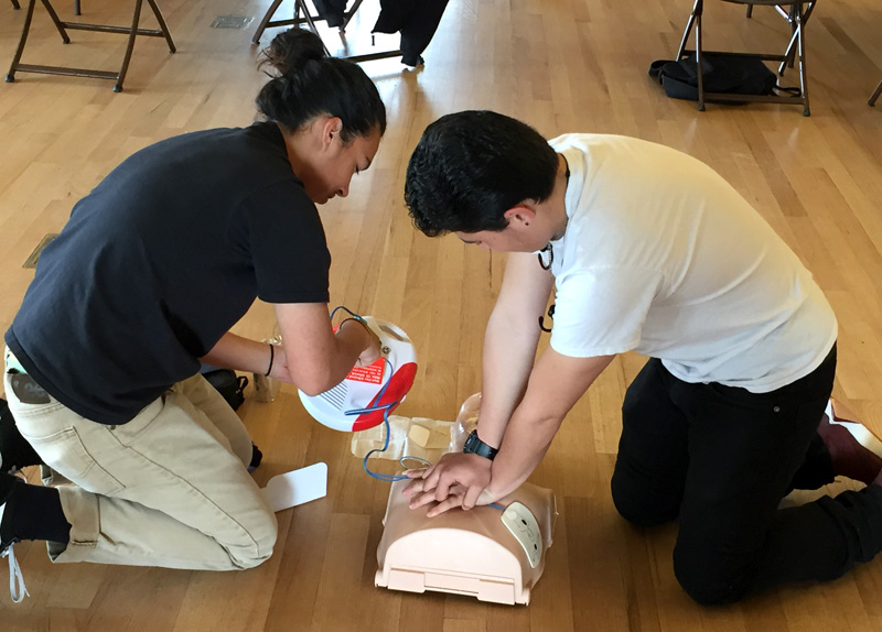 Colma residents learning CPR