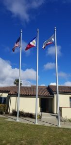 American, Philippine and Colma Town Flags
