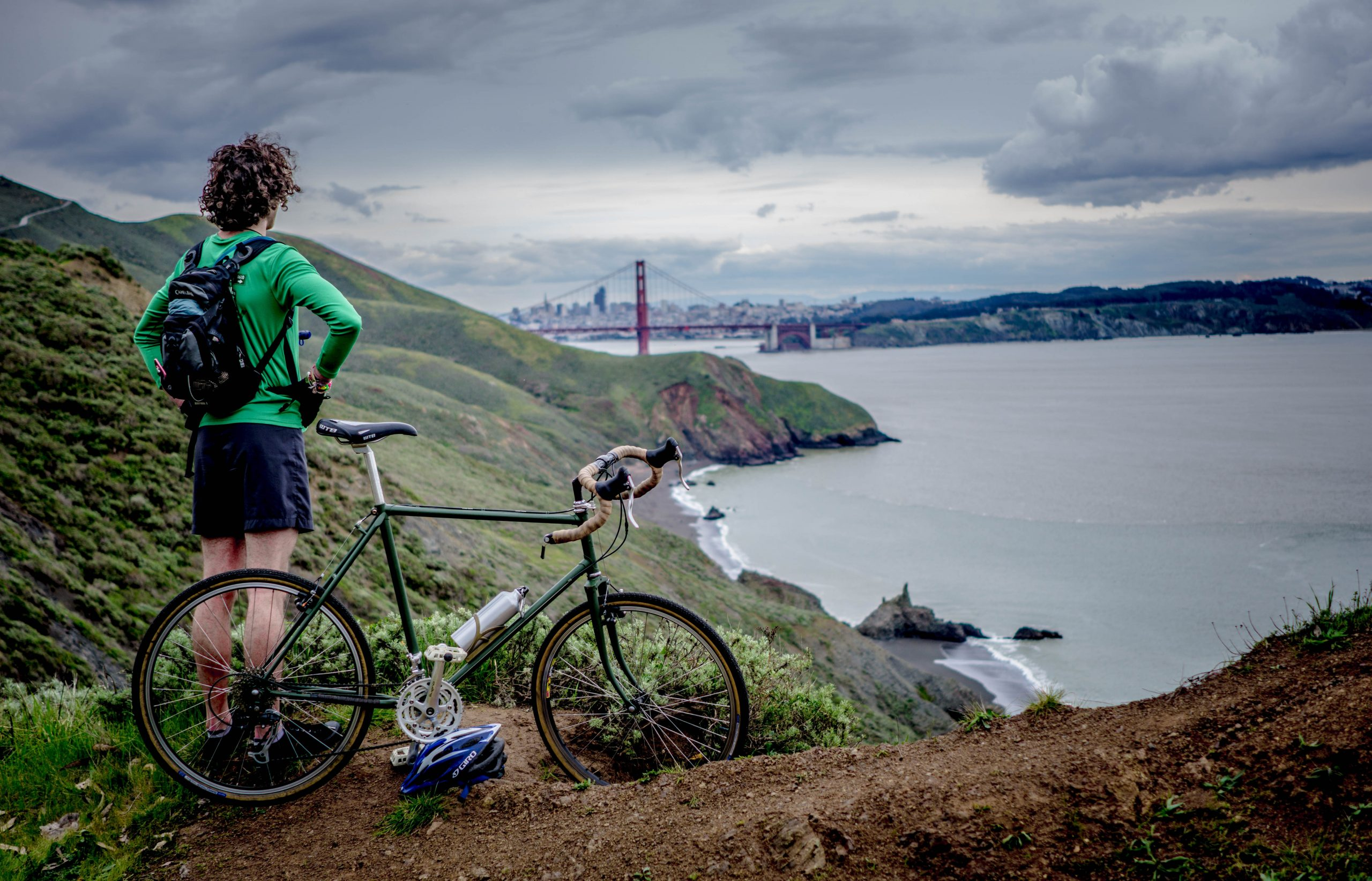 Person on roadside with bike overlooking the bay