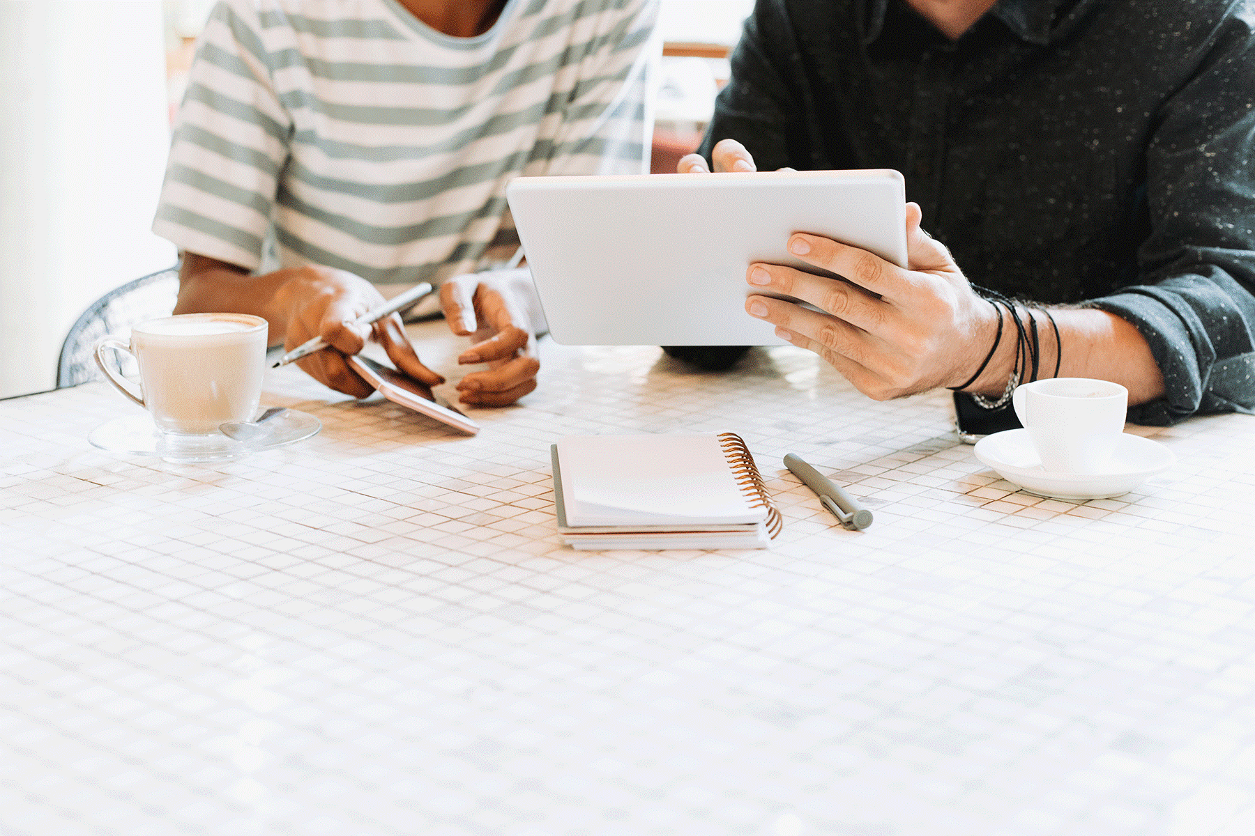 Two people looking at a tablet