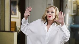 Moira Rose of Schitt's Creek gestures animatedly.