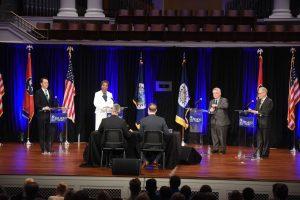 Four candidates during Mayoral Debate