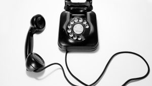Black rotary dial phone on white surface photo by @quinoal on Unsplash