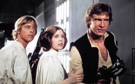 Luke Skywalker, Leia Skywalker and Han Solo stand together in support of saving the galaxy.