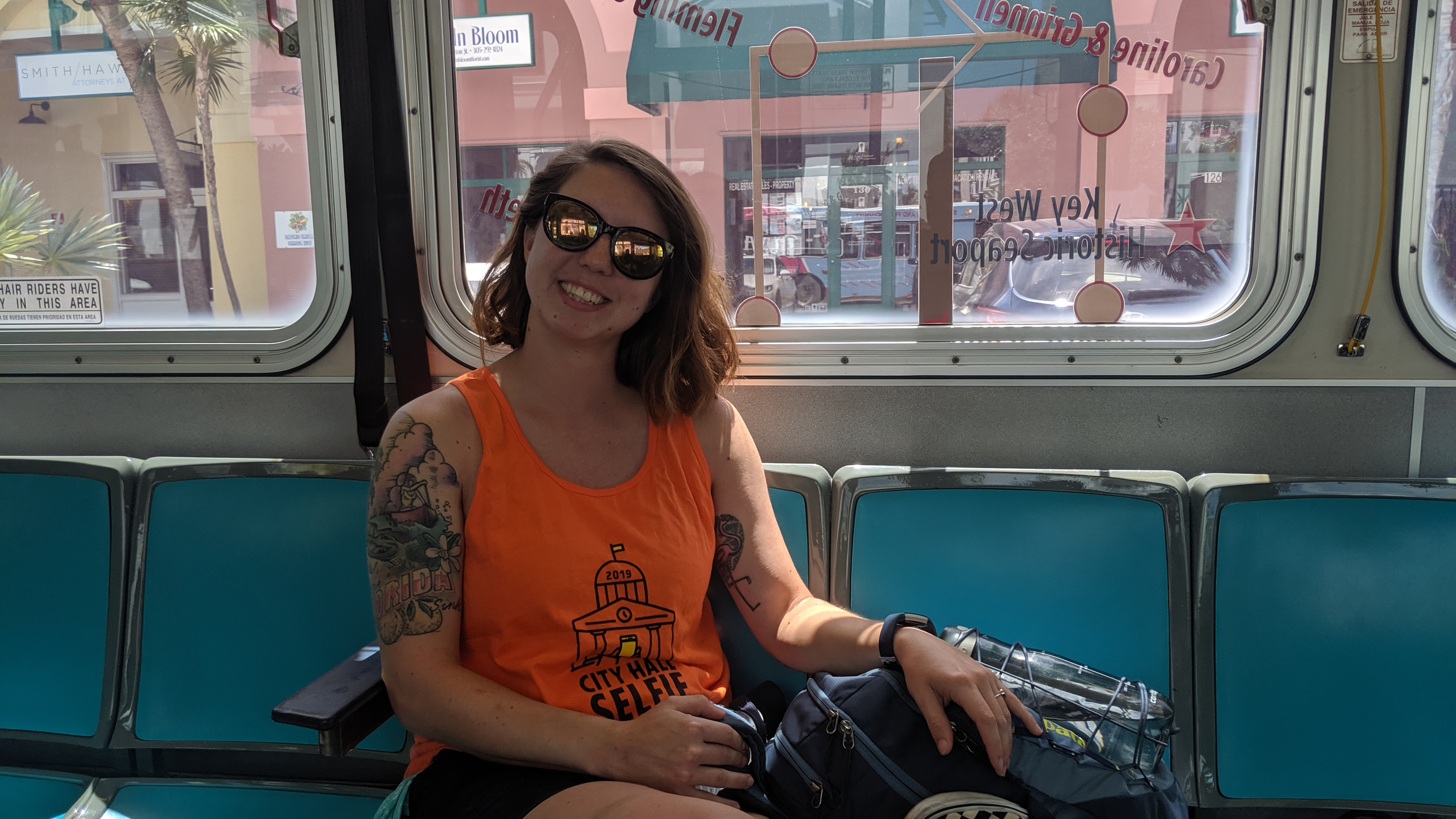 woman smiling on a city bus