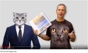 guy in cat t-shirt holding budget document next to CG cat