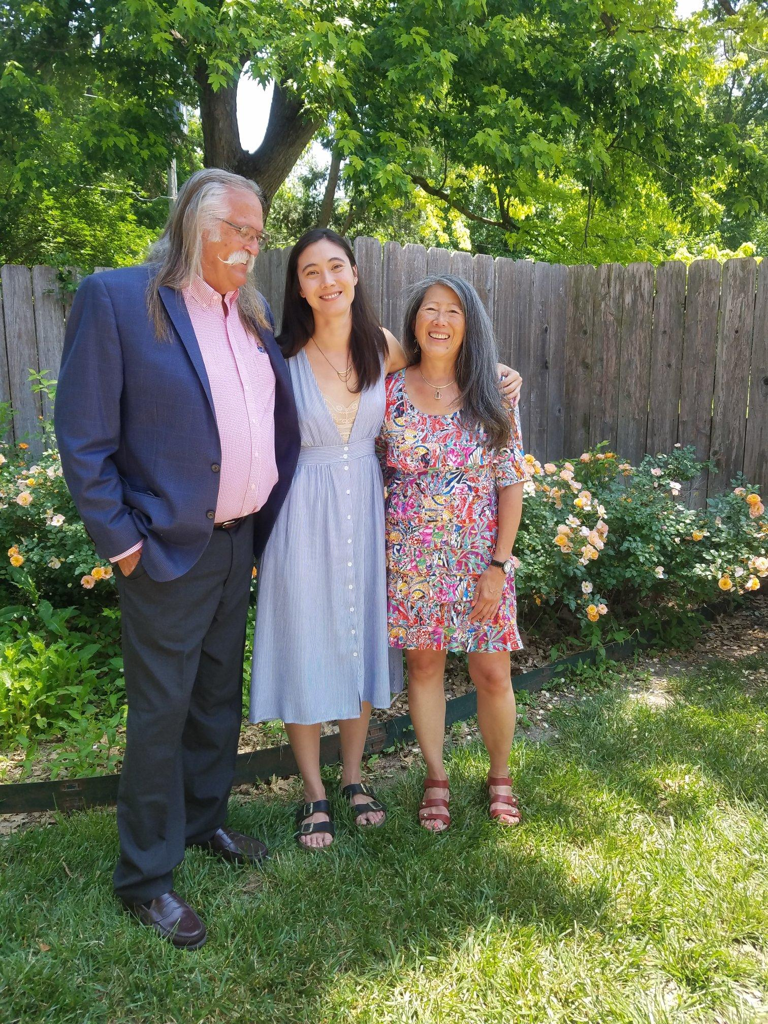 Author poses with her mom and dad