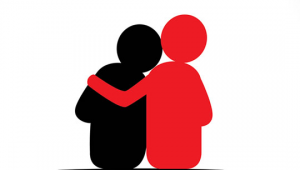 Someone hugging another person