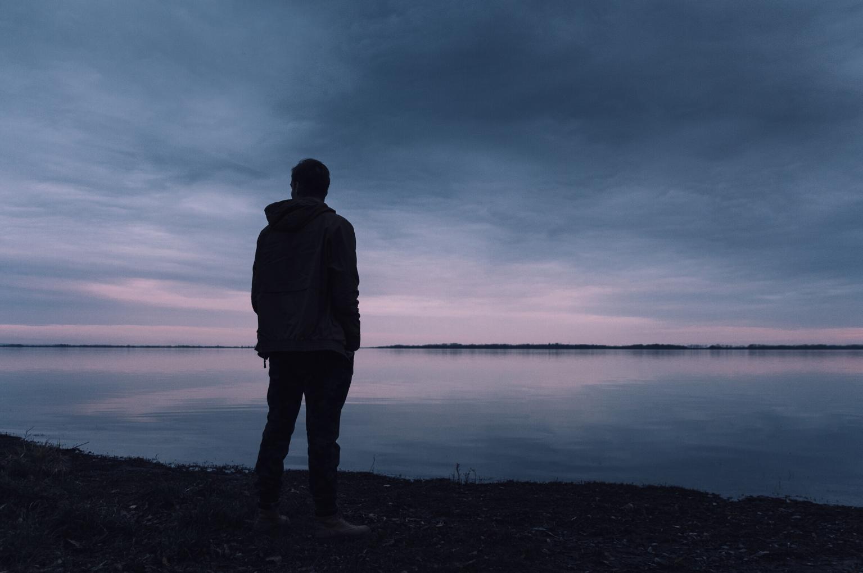 man and lake