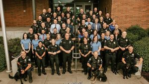 Staff photo of McMinnville police department. Large group of police officers standing on steps.