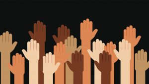 Multi-racial hands raised