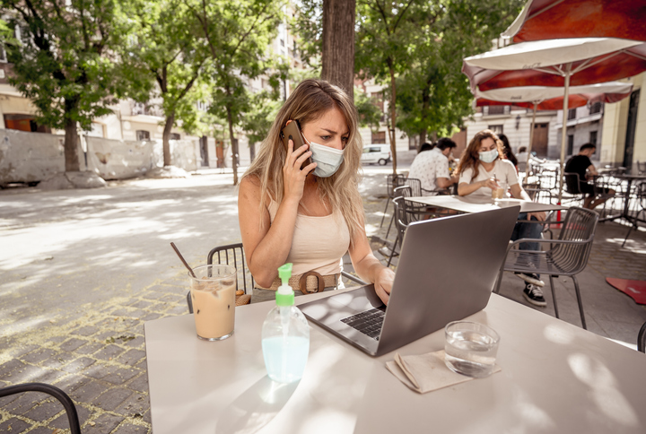 woman conducting business online, outdoors