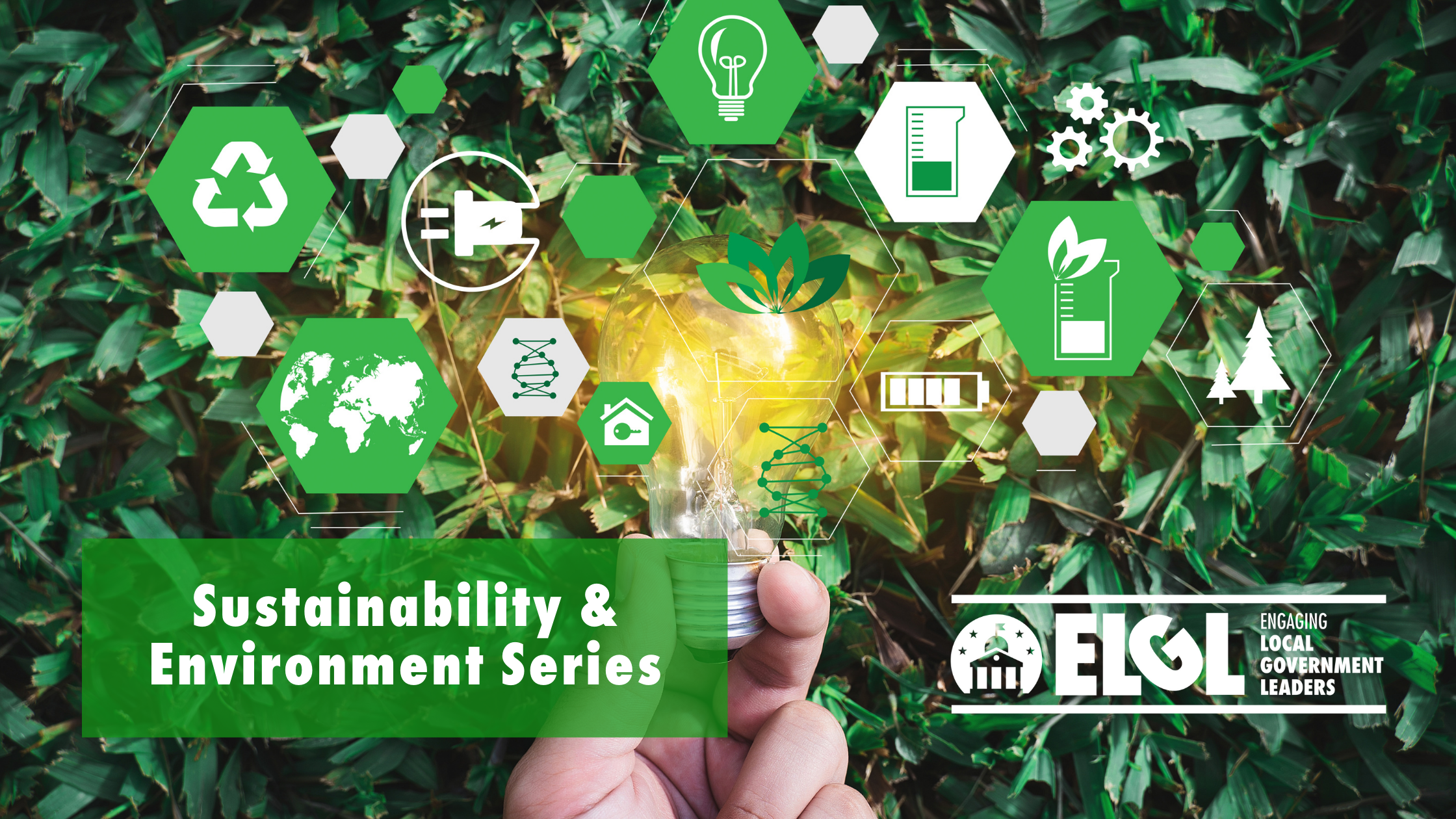 Image with hand holding up various environmentally related logos