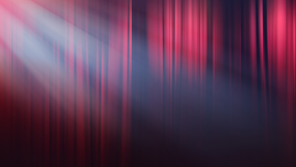 A red curtain with a spotlight.