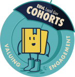 """Round badge with cartoon book that says """"ELGL Local Gov Cohorts: Valuing Engagement"""""""