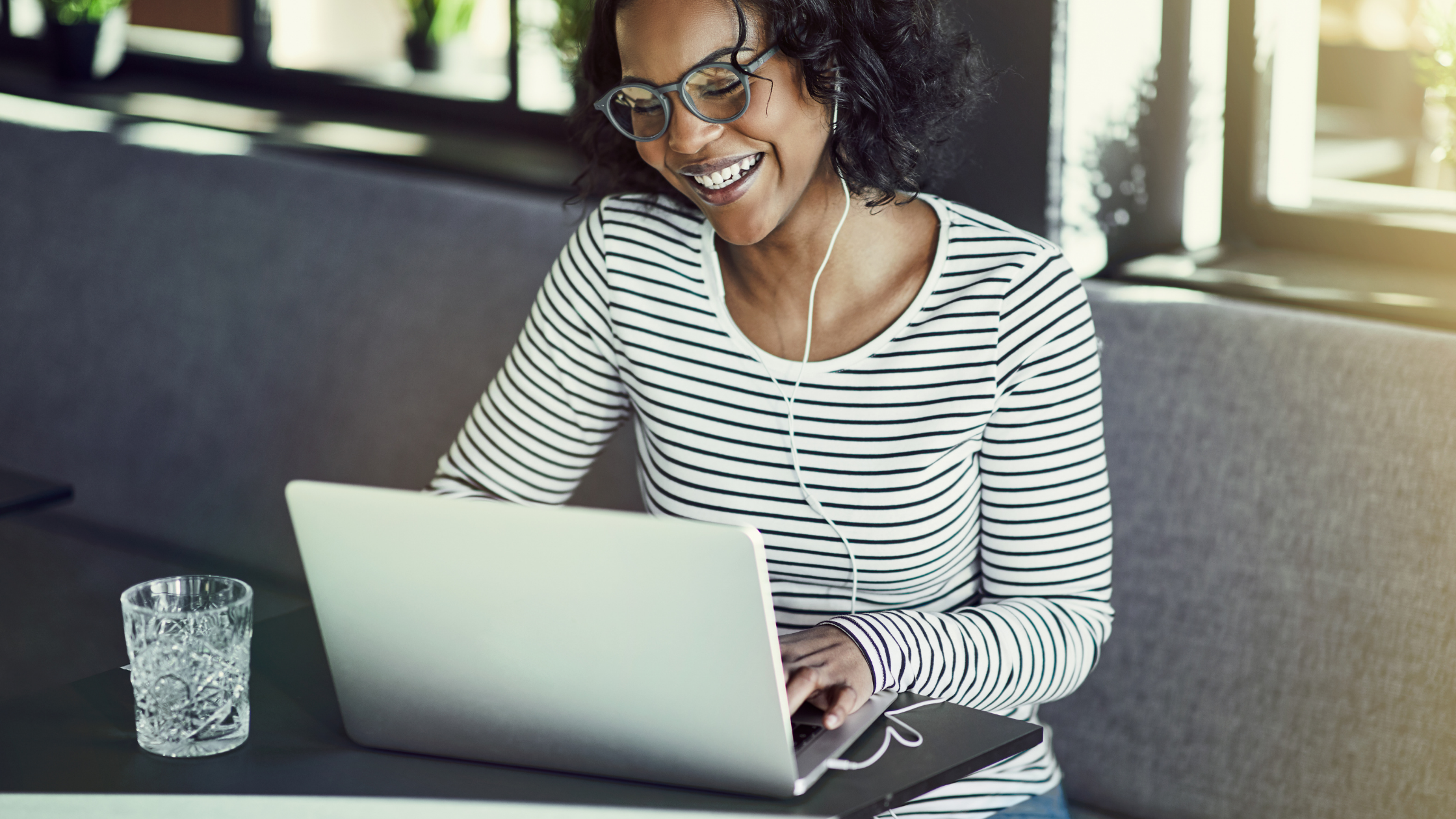 woman sitting on computer smiling