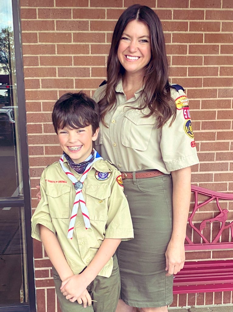 young boy scout with female troop leader