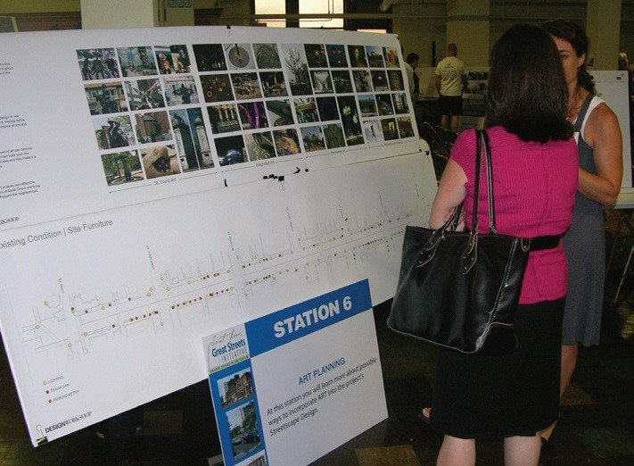 People at community meeting reviewing board