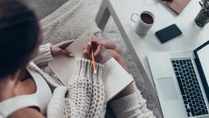 Women writing at desk