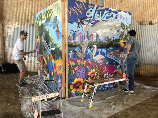 Artist J Muzacz and a fellow community member in Austin, TX