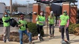 Eco volunteers in green shirts