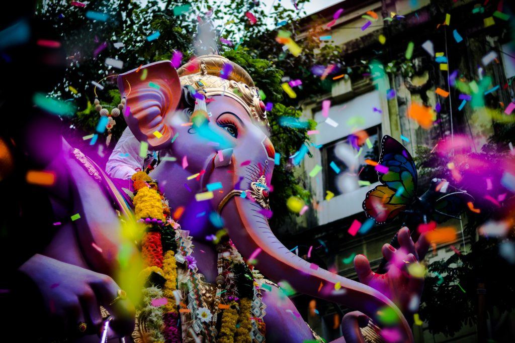 A parade with a bunch of colorful confetti