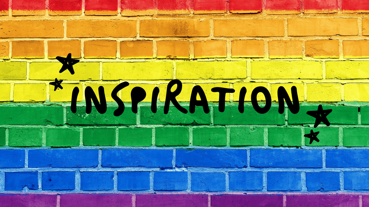 Black inspiration text with black stars on either side of the word. Background is brick wall in rainbow colors