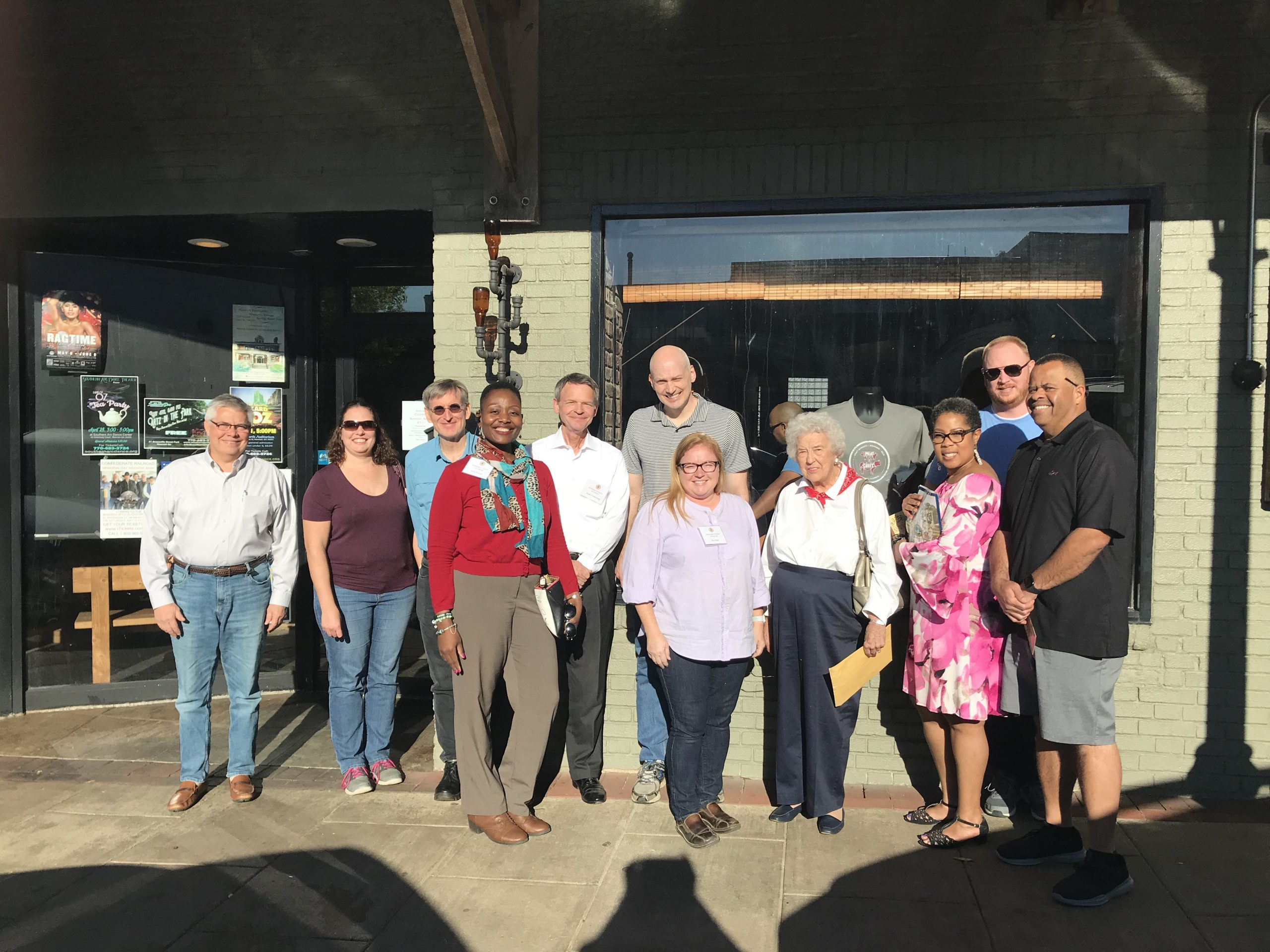 A photo of the 2019 Newnan Citizen Academy class with local Newnan historian, Elizabeth Beers at one of downtown Newnan's treats – Meat N' Greet