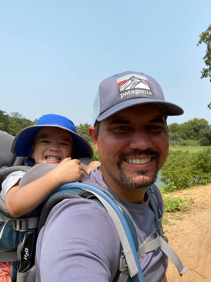 Matt with his kid hiking