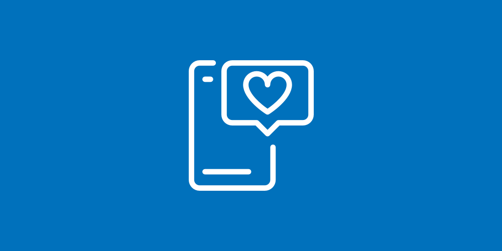 Icon of a mobile phone with a social media message that includes a heart.