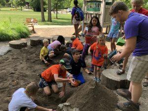Habitat Summer Camp Volunteer helping campers