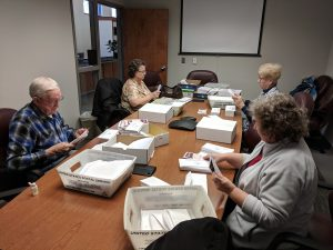 Volunteers preparing a mailing to our residents.