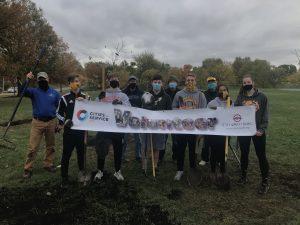 Volunteers assisting in a tree planting