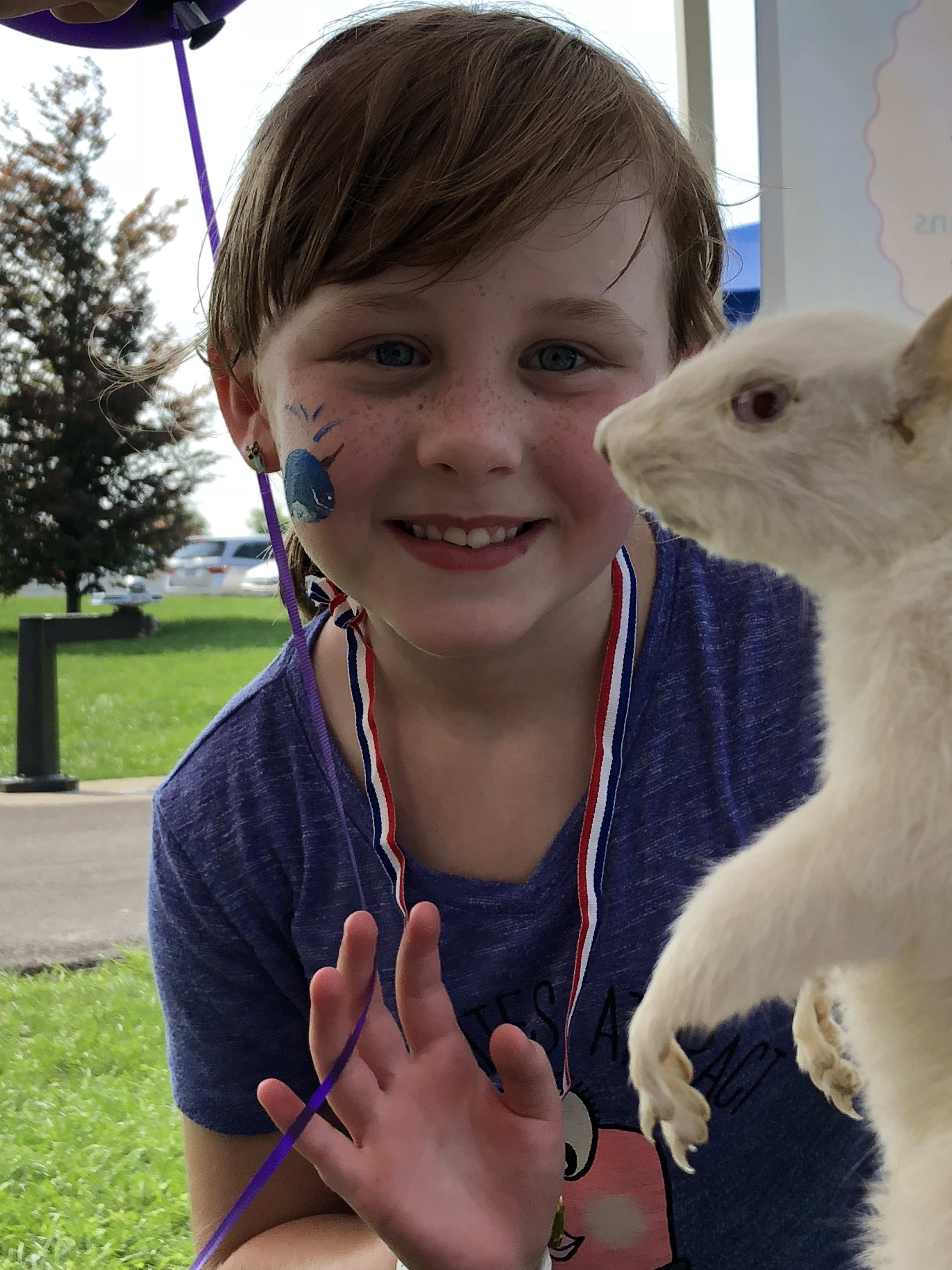 child with squirrel