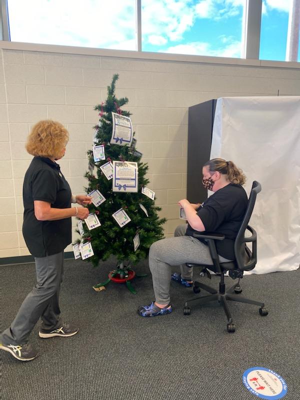 women decorating tree