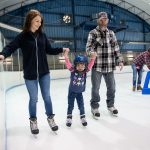 parents and child skating